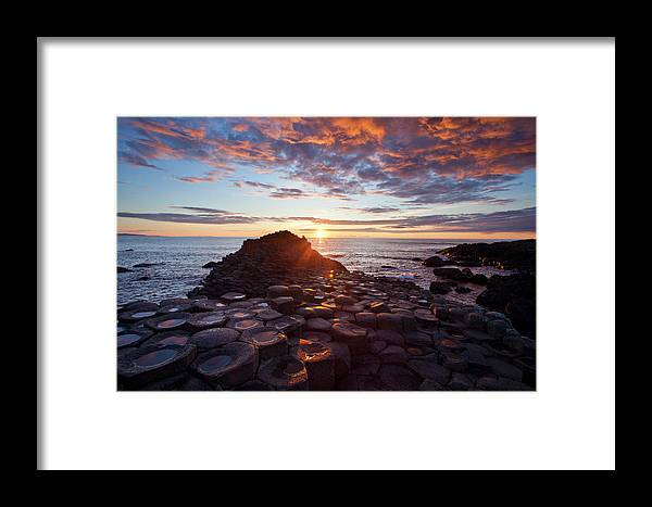 Water's Edge Framed Print featuring the photograph Sunset Over The Giants Causeway by Gareth Mccormack