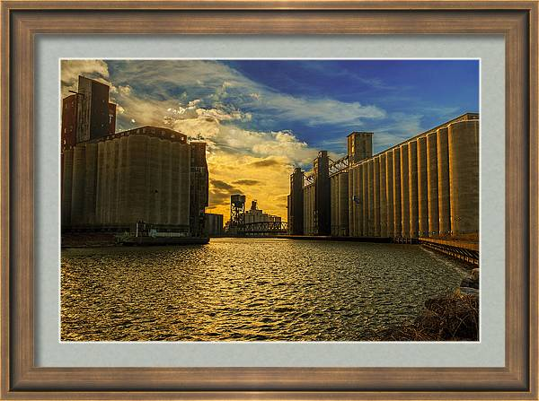 Sunsets on a river through an Industrial Canyon by Chris Bordeleau