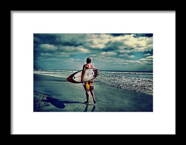 � Jamesdavidphotography; Photo; Photograph; Horizontal; Surf; Surfing; Surf Board; Board; Plank; Short; Long; Sport; Wet; Ocean; Pacific; Male; Teen; Wave; Breaker; Shore; Dscf3490; Lucisart; Fuji S5 Pro; Sand; Wave; Cloudly; Dramatic Framed Print featuring the photograph Surfer Walking The Beach by James David Phenicie