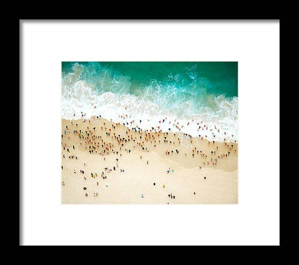 Water's Edge Framed Print featuring the photograph Swimmers Entering The Ocean by Tommy Clarke
