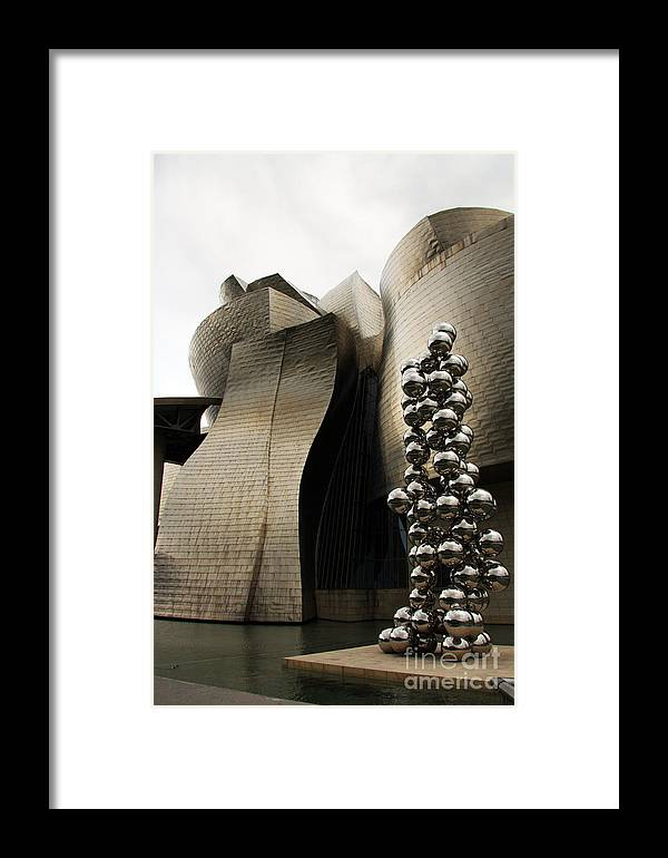Sculpture Framed Print featuring the photograph Tall Tree And The Eye by Juan Romagosa