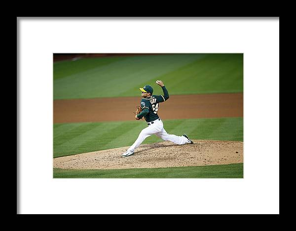 People Framed Print featuring the photograph Tampa Bay Rays V Oakland Athletics by Michael Zagaris