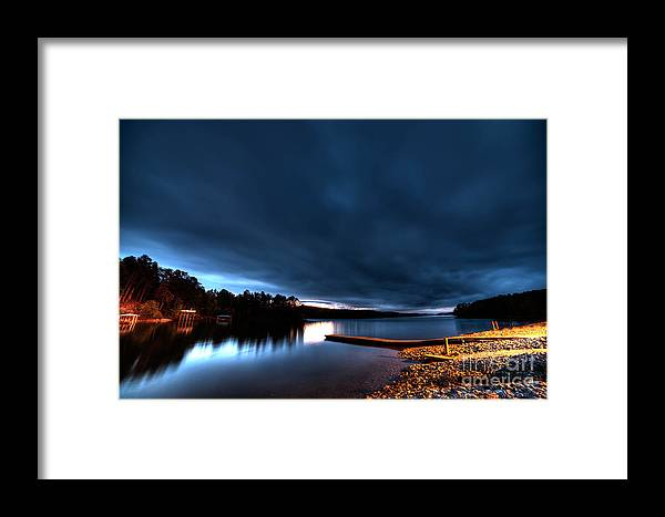 The Lake Tator Hole In Granite Falls With Heavy Clouds And A Sunset. Framed Print featuring the photograph Tator Hole 14mm Sunset by Robert Loe