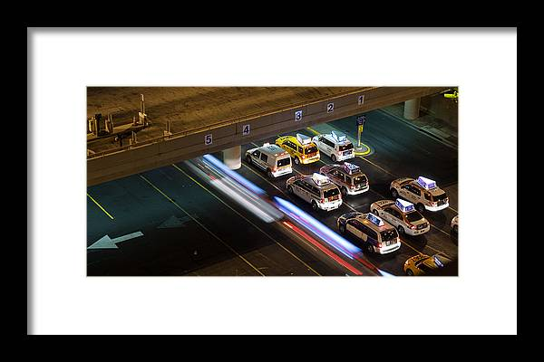 Airport Framed Print featuring the photograph Taxis At Mccarran by Kevin Grant