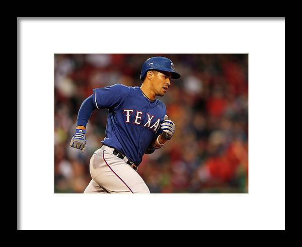 American League Baseball Framed Print featuring the photograph Texas Rangers V Boston Red Sox by Jim Rogash