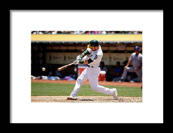 People Framed Print featuring the photograph Texas Rangers V Oakland Athletics by Ezra Shaw