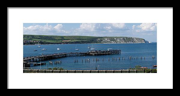 The Bay At Swanage Framed Print featuring the photograph The Bay At Swanage by Wendy Wilton
