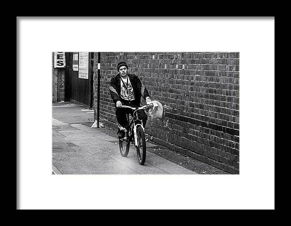 Framed Print featuring the photograph The Biker by YAWAT DJAMEN William