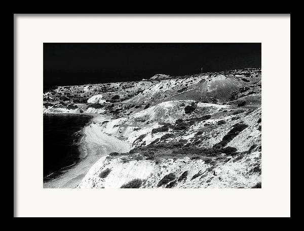 The Black Coast Framed Print featuring the photograph The Black Coast by John Rizzuto