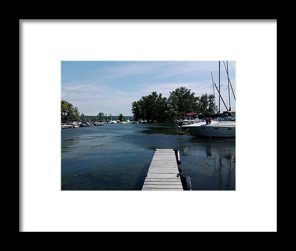 Water Framed Print featuring the photograph The Boat Dock by Jo-Ann Hayden