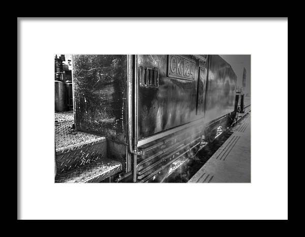 The Door Of Steam Train Framed Print featuring the photograph The Door Of Steam Train by Dewa Wirabuwana
