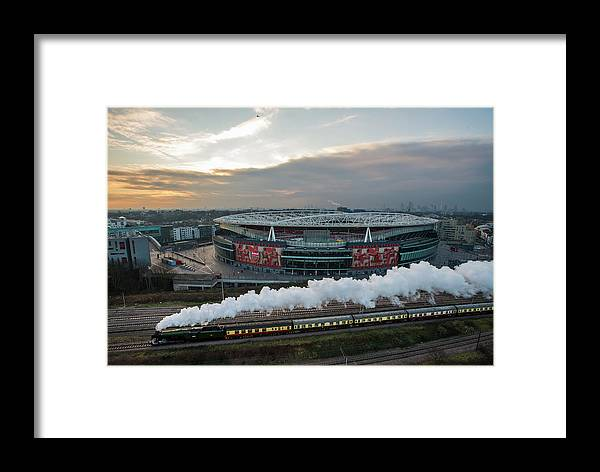 The Emirates Stadium Framed Print featuring the photograph The Flying Scotsman Travels The East by Justin Setterfield
