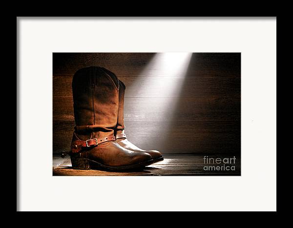 Boots Framed Print featuring the photograph The Found Boots by Olivier Le Queinec