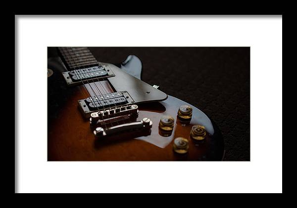 Guitar Framed Print featuring the photograph The Guitar by Dasmin Niriella