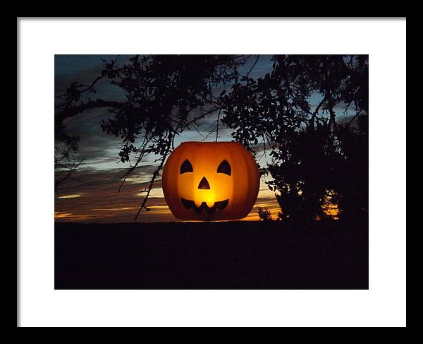 A Hanging Pumpkin At Sunset On 10/17/13 Framed Print featuring the photograph The Hanging Pumpkin by Rebecca Cearley
