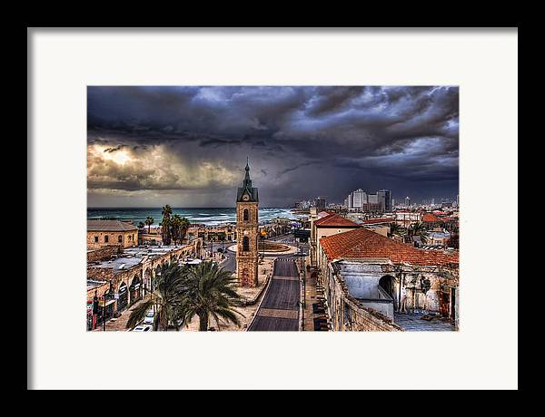 Clock Tower Framed Print featuring the photograph the Jaffa old clock tower by Ronsho