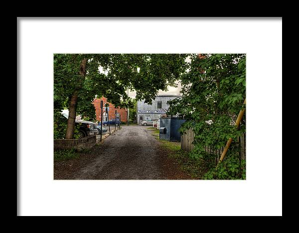 Cityscape Framed Print featuring the photograph The Lane by John Herzog