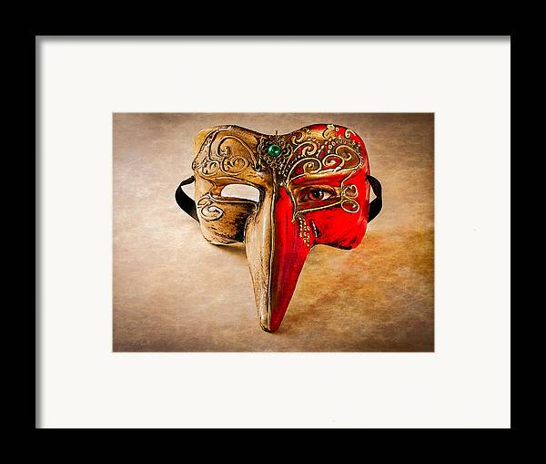 Mask Framed Print featuring the photograph The Mask On The Floor by Bob Orsillo