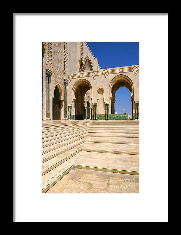 Colonnades Leading To Mosque Framed Print featuring the photograph The Massive Colonnades leading to the Hassan II Mosque Sour Jdid Casablanca Morocco by PIXELS XPOSED Ralph A Ledergerber Photography