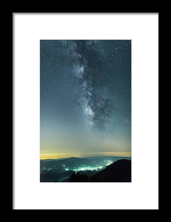 Scenics Framed Print featuring the photograph The Milky Way Hovering Above A Town by Trevor Williams