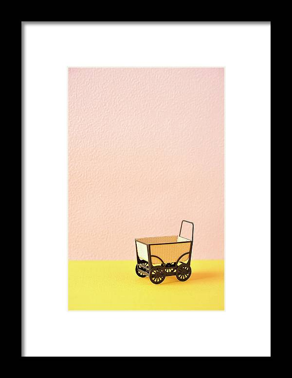Baby Carriage Framed Print featuring the photograph The Model Of The Baby Carriage Made Of by Yagi Studio