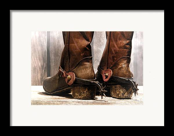 Cowboy Framed Print featuring the photograph The Muddy Boots by Olivier Le Queinec