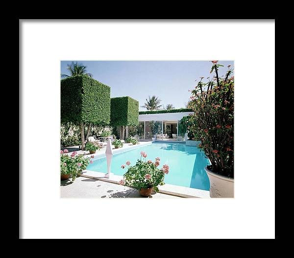 Architecture Framed Print featuring the photograph The Pool And Garden Of A Home by William Grigsby