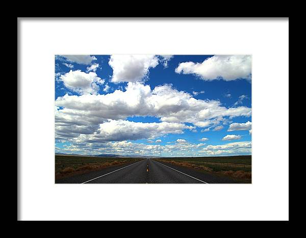 Highway Framed Print featuring the photograph The Road Goes On by Lynn Hopwood