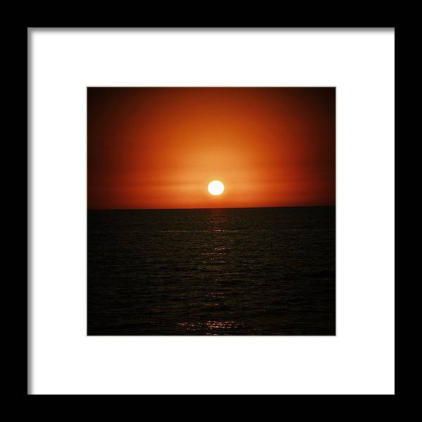 Ocean Framed Print featuring the photograph The Setting Sun by Natasha Marco