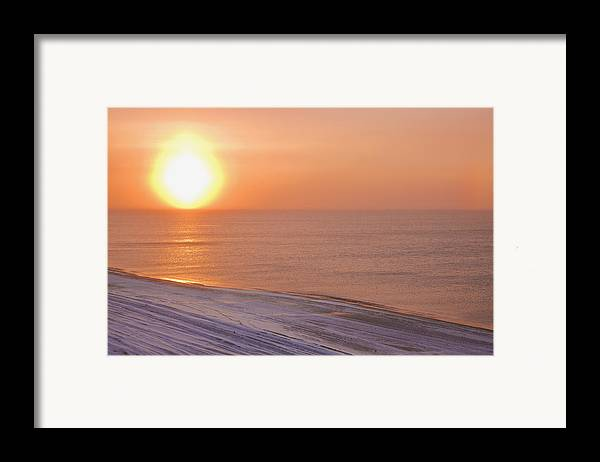 Sundog Framed Print featuring the photograph The Setting Sun Shining Through by Kevin Smith