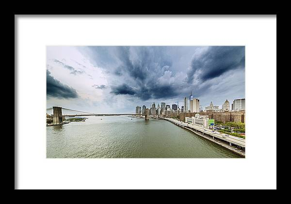 Manhattan Framed Print featuring the photograph The Storm Over Manhattan Downtown by Alex Potemkin