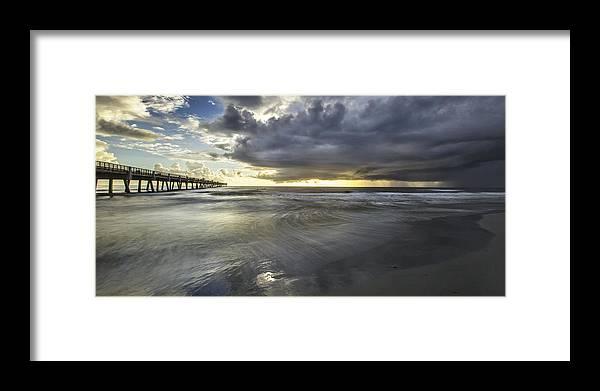 Jacksonville Beach Pier Framed Print featuring the photograph The Sun Is The Winner by Razvan Balotescu