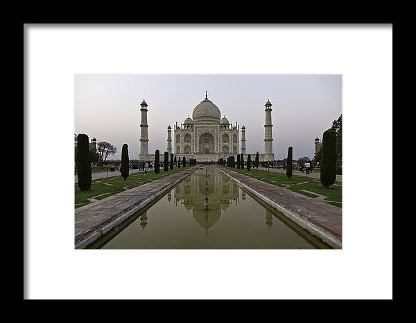 The Taj Mahal Framed Print featuring the photograph The Taj Mahal In Agra India At Dusk. by Alan Gillam