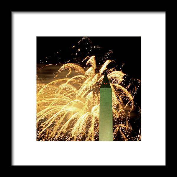 Firework Display Framed Print featuring the photograph The Washington Monument And Fireworks by Hisham Ibrahim