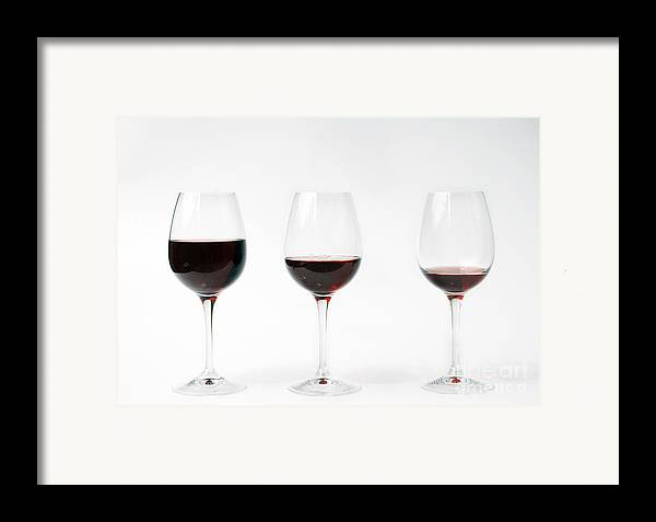 Three Framed Print featuring the photograph Three Glasses Of Wine by Patricia Hofmeester
