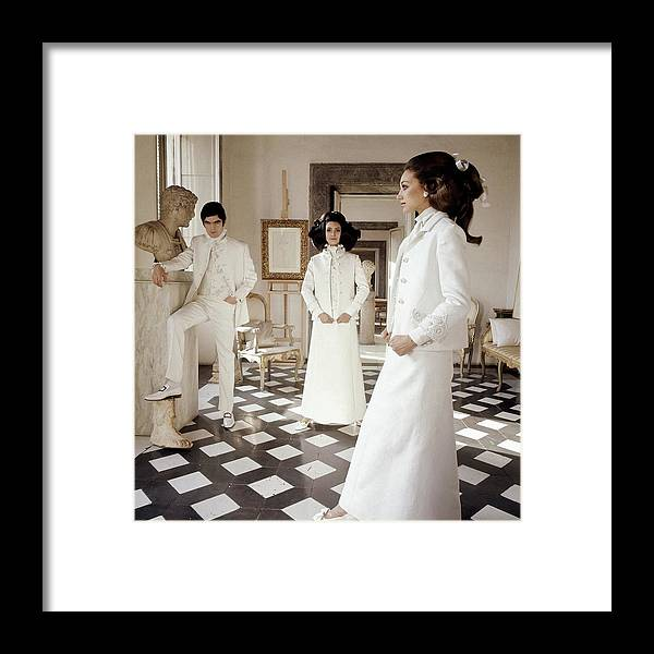 Accessories Framed Print featuring the photograph Three Models Wearing Clothing By Valentino by Henry Clarke