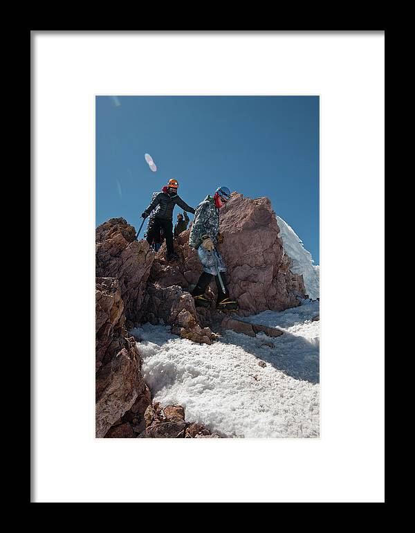Young Man Framed Print featuring the photograph Three People Climb Down Rocks by Beth Wald