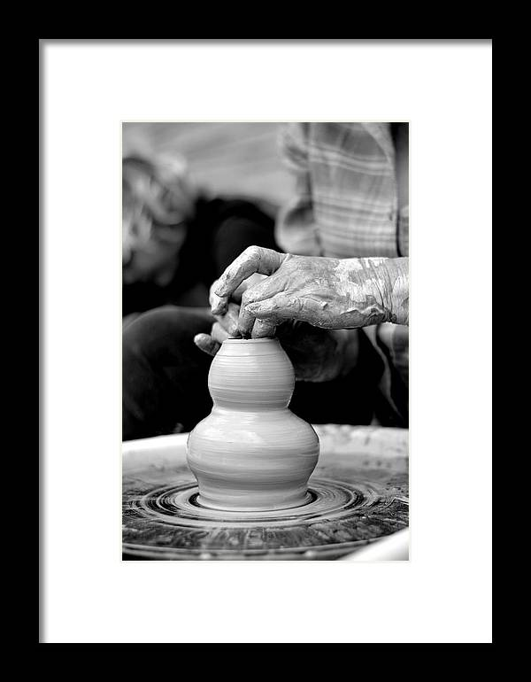 Pottery Framed Print featuring the photograph Throwing On The Pottery Wheel by Megan Luschen