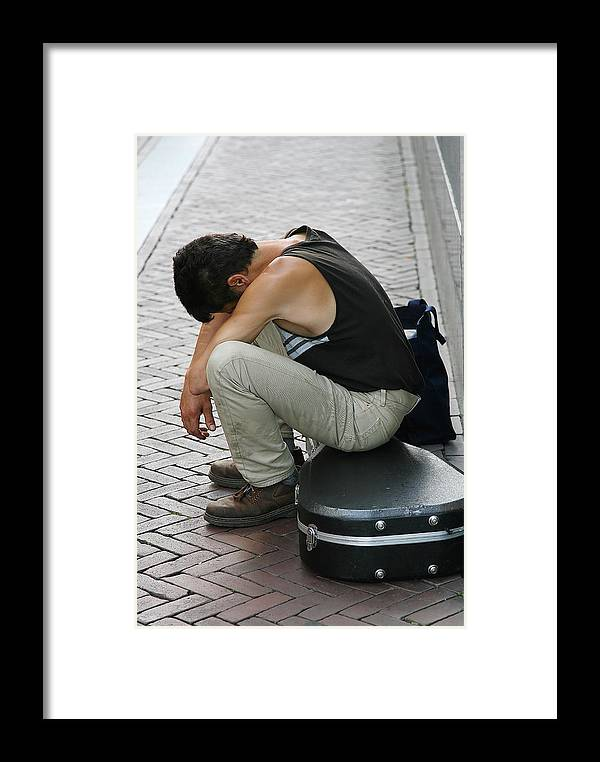 Man Framed Print featuring the photograph Tired Street Artist by Peter Zijlstra