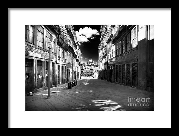 To The Light In Porto Framed Print featuring the photograph To The Light In Porto by John Rizzuto