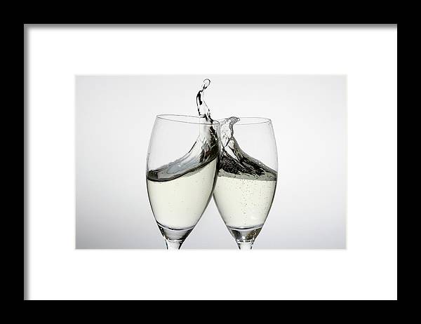 Alcohol Framed Print featuring the photograph Toasting With Two Glasses Of Champagne by Dual Dual