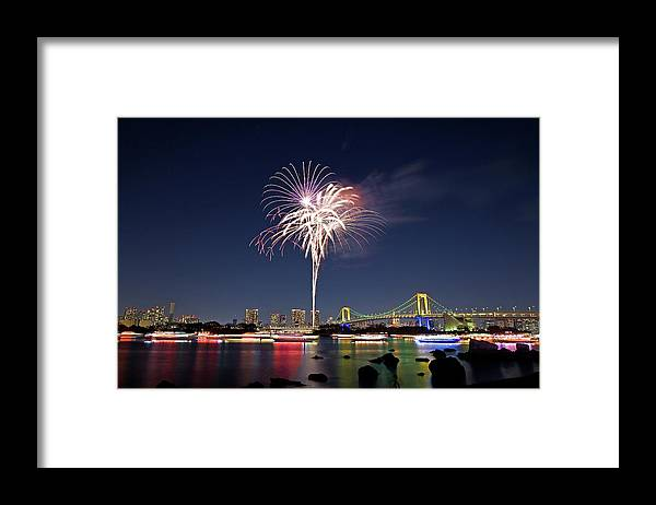 Firework Display Framed Print featuring the photograph Tokyo Bay Fireworks by Photography By Zhangxun