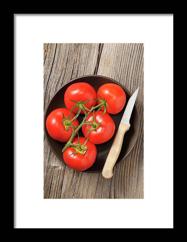 Kitchen Knife Framed Print featuring the photograph Tomato by Riou