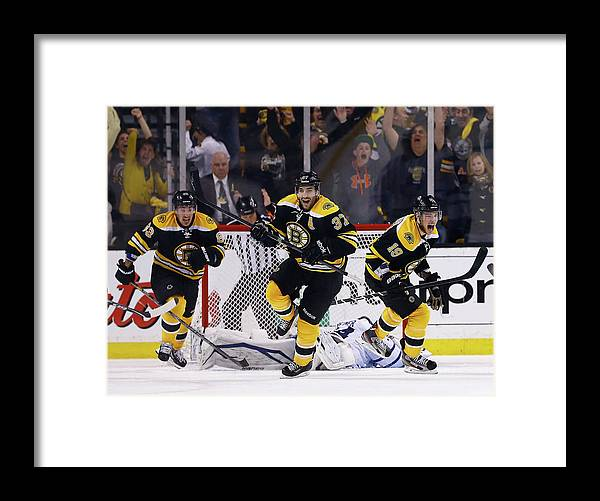 Following Framed Print featuring the photograph Toronto Maple Leafs V Boston Bruins - by Jared Wickerham