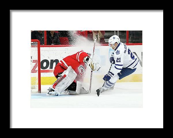 North Carolina Framed Print featuring the photograph Toronto Maple Leafs V Carolina by Gregg Forwerck