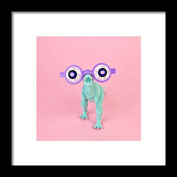 Purple Framed Print featuring the photograph Toy Dinosaur With Spooky Glasses by Juj Winn