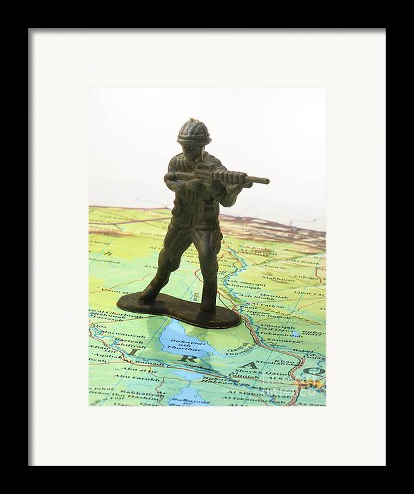 Aggression Framed Print featuring the photograph Toy Solider On Iraq Map by Amy Cicconi