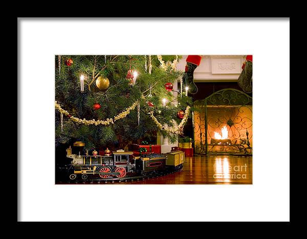 christmas framed print featuring the photograph toy train under the christmas tree by diane diederich - Train Under Christmas Tree