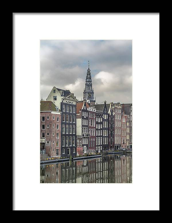 In A Row Framed Print featuring the photograph Traditional Dutch Houses Over A Canal by Buena Vista Images