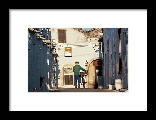People Framed Print featuring the photograph Trulli Houses Alberobello Apulia Puglia by Peter Adams